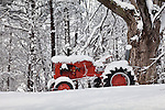 Red tractor in fresh snow in Fitchburg, MA, USA