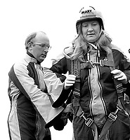 Mary Peters, N Ireland, Olympic Gold Medallist, women's pentathlon, gets her harness checked before her first ever parachute jump over Newtownards Airport, Co Down, N Ireland. 26h November 1974. With her in the photo is Colin Wallace, Ministry of Defence employee at British Army HQ, Thiepval Barracks, Lisburn.197411260667k<br />