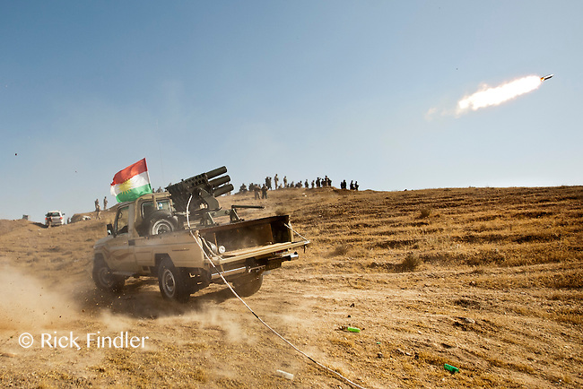 """DIYALA PROVINCE, KURDISTAN. 14.06.14 Members of the Kurdish armed fighters (also known as """"peshmerga"""") fire heavy artillary during clashes between Kurdish fighters and ISIS militants. ISIS have gained signifant ground and ammunition since taking over Mosul, Iraq's second largest city."""