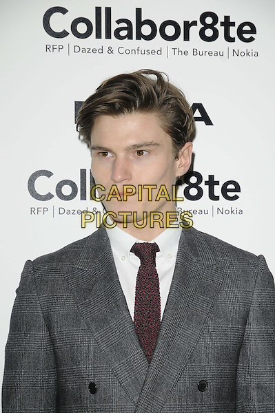 "Oliver Cheshire.The ""Collabor8te"" VIP film screening, Regent Street Cinema, University of Westminster, Regent St., London, England..February 12th, 2013.headshot portrait red maroon crochet tie white shirt black jacket grey gray suit .CAP/CAN.©Can Nguyen/Capital Pictures."