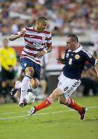 May 26, 2012:   USA Men's National Team m Jermaine Jones (13) tries to intercept the ball from Scotland Scott Brown (8) during action between the USA and Scotland at EverBank Field in Jacksonville, Florida.  USA defeated Scotland 5-1.............