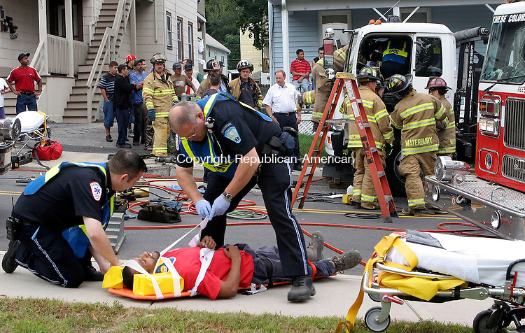 WATERBURY, CT-28September 2006-092806TK13- EMT Paramedics prepare to take the driver of a truck involved  in an accident at the intersection of River Street and East Liberty Street in Waterbury Thursday afternoon to a waiting ambulance. Tom Kabelka Republican-American