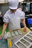 Making kamaboko containing vegetables, Tsukugon kamaboko factory and shop, Tokyo, Japan, August 28, 2009.