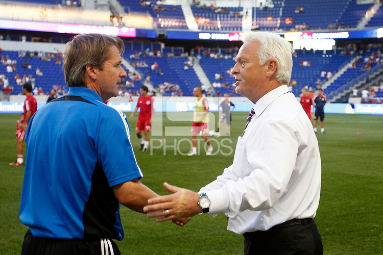 New York Red Bulls head coach Hans Backe (R) and San Jose Earthquakes head coach Frank Yallop (L) shake hands before the game. The New York Red Bulls defeated the San Jose Earthquakes 2-0 during a Major League Soccer (MLS) match at Red Bull Arena in Harrison, NJ, on August 28, 2010.