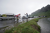 small group of riders over the top of the Col de Joux Plane (HC/1691m/11.6km/8.5%) and starting their descent towards the finish in horrendous conditions<br /> <br /> Stage 20: Meg&egrave;ve &rsaquo; Morzine (146.5km)<br /> 103rd Tour de France 2016