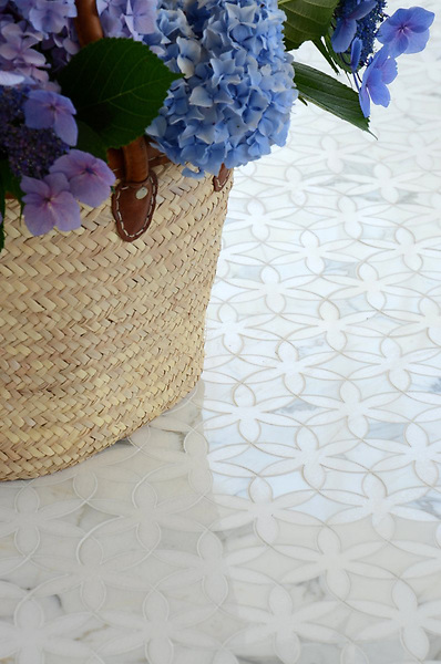 Fiona, a stone waterjet mosaic shown in Thassos and Calacatta Tia polished, is part of the Silk Road collection by Sara Baldwin for New Ravenna.
