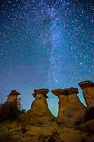 Escanante National Monument, UT<br /> A group of sandstone hoodoos and the evening sky