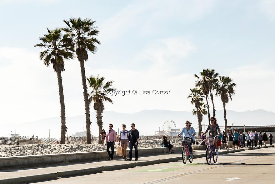 Cyclists ride between Santa Monica and Venice on the oceanside bike path. Santa Monica, California. Los Angeles area.