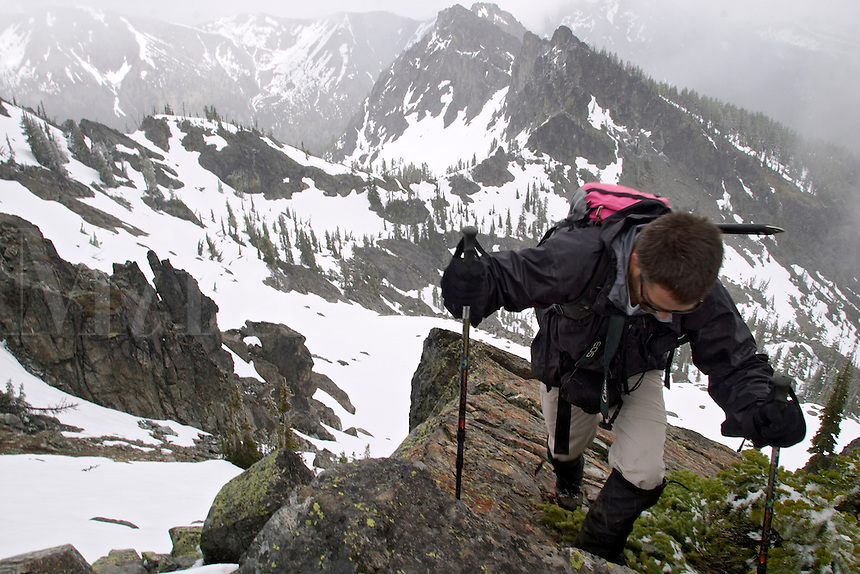 Man climbing in snowy mountains, Esmeralda Peak, Kittitas County, Cascade Mountains, Washington, USA