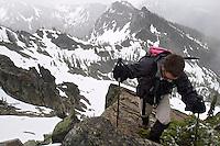 Man climbing in snowy mountains, Esmeralda Peak, Kittitas County, Cascade Mountains, Washington, USA