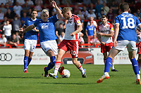 Ben Kennedy of Stevenage is tackled by Steve McNulty of Tranmere Rovers during Stevenage vs Tranmere Rovers, Sky Bet EFL League 2 Football at the Lamex Stadium on 4th August 2018