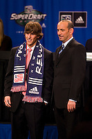 MLS Commissioner Don Garber with the fifth pick of the draft, Wells Thompson who was picked by the New England Revolution during the first round of the MLS SuperDraft at the Indiana Convention Center, Indianapolis, IA, on Jan 12, 2007.