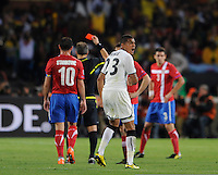 Kevin Prince Boateng of Ghana celebrates as Aleksander Lukovic of Serbia is sent off for a 2nd yellow card