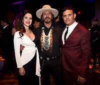 """LOS ANGELES - AUGUST 27: (L-R) Carla Baratta, Raoul Max Trujillo and Co-Creator/Executive Producer/Writer/Director Elgin James attend the post party at Sunset Room Hollywood following the season two red carpet premiere of FX's """"Mayans M.C"""" on August 27, 2019 in Los Angeles, California. (Photo by Frank Micelotta/FX/PictureGroup)"""