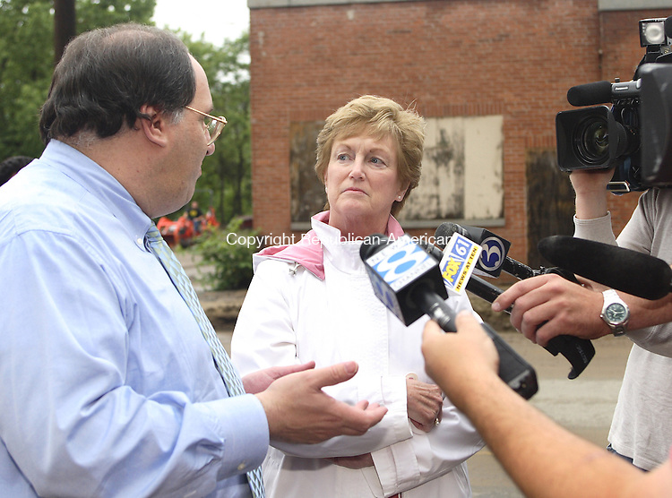 WATERBURY,CT-03 JUNE 2006-060306MK08- Connecticut Governor Jodi Rell, along with Waterbury Mayor Michael J. Jarjura speak to the media and describe the damage from a early morning mudslide along South Main Street in Waterbury Saturday afternoon. Michael Kabelka / Republican American. (Connecticut Governor Jodi Rell, along with Waterbury Mayor Michael J. Jarjura)CQ