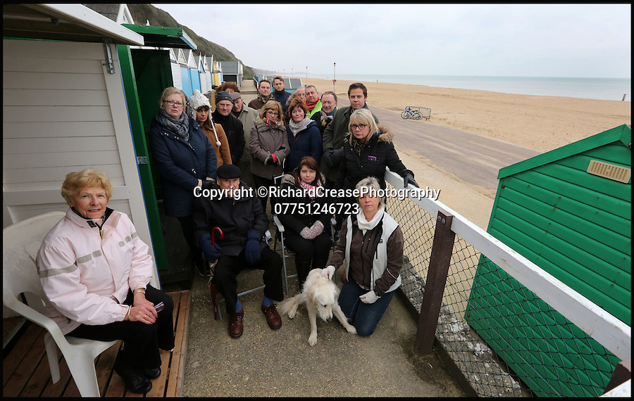 "BNPS.co.uk (01202 558833)<br /> Pic: RichardCrease/BNPS<br /> <br /> The angry group of beach hut owners whose stunning views are shortly to be ruined.<br /> <br /> Beach hut owners fury after sea views are blocked...by more beach huts.<br /> <br /> Irate beach hut owners have slammed a council who have allowing a row of beach huts to be built directly in front of them blocking their beautiful sea views.<br /> <br /> Owners who pay £1,094 a year to the council to have a beach hut there will instead have to make do with the view of the back of another beach hut.<br /> <br /> Furious owners in the Manor Steps area in Bournemouth, Dorset, are demanding action after being told of plans to place more huts between them and the beach by the end of the month.<br /> <br /> They claim their views of the sea, beach and prom will be completely blocked and that the council has not consulted them on the plans.<br /> <br /> Bournemouth Borough Council said the move is necessary to allow for the creation of a turning circle for the newly-routed land train.<br /> <br /> Mrs Vincent, who has owned a beach hut for more than 50 years, said: ""What's the point of owning a beach hut if all you can see is the back of another hut?"