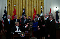 United States President Donald J. Trump and Liu He, China's vice premier, sign a trade agreement between the United States and China in the East Room of the White House in Washington D.C., U.S., on Wednesday, January 15, 2020.  <br /> <br /> Credit: Stefani Reynolds / CNP/AdMedia