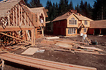 Bellevue, Washington,New home owners check the progress on their house under construction in Pacific Northwest, West Coast, USA