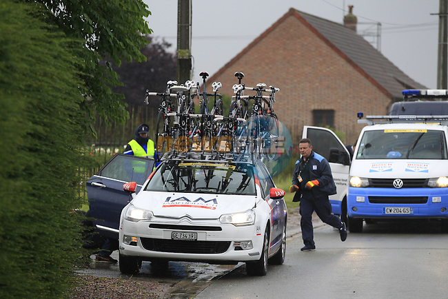 Puncture for IAM Cycling team car before the1st cobbled sector 9  from Gruson to Crossroads de l'Arbe during Stage 5 of the 2014 Tour de France running 155.5km from Ypres to Arenberg. 9th July 2014.<br /> Picture: Eoin Clarke www.newsfile.ie
