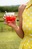 USA, Tennessee, Nashville, Iroquois Steeplechase, woman drinking Moonshine Cherry-Basil Blush
