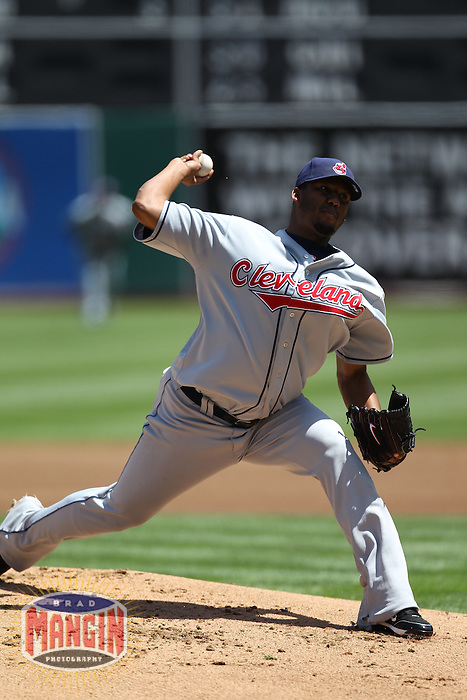 OAKLAND, CA - APRIL 24:  Fausto Carmona #55 of the Cleveland Indians pitches against the Oakland Athletics during the game at Oakland-Alameda County Coliseum on April 24, 2010 in Oakland, California. Photo by Brad Mangin