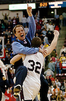Lower Merion basketball coach Gregg Downer, left, leaps into the arms of player Pete Lucas, right, following their 60-58 victory over Schenley in the Class AAAA boys PIAA Championship Saturday, March 25, 2006, in Hershey, Pa. (AP Photo/Bradley C Bower)