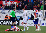 Real Madrid's German midfielder Toni Kroos receives yellow card during the Spanish league football match Club Atletico de Madrid vs Real Madrid CF at the Vicente Calderon stadium in Madrid on February 7, 2015.        PHOTOCALL3000/ DP
