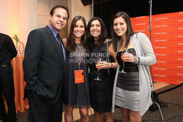 Fashion designer Dayna Shay Teitelbaum poses with guests at the Syracuse University 2011 Fashion Show, at One Chase Plaza.