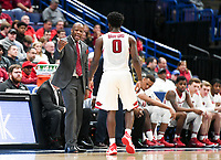 NWA Democrat-Gazette/CHARLIE KAIJO Arkansas Razorbacks head coach Mike Anderson talks to Arkansas Razorbacks guard Jaylen Barford (0) as he returns to the bench during the Southeastern Conference Men's Basketball Tournament, Thursday, March 8, 2018 at Scottrade Center in St. Louis, Mo.