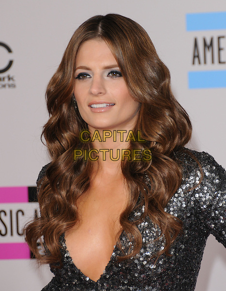 STANA KATIC .At The 2010 American Music  Awards held at Nokia Theatre L.A. Live in Los Angeles, California, USA,.November 21st 2010..amas arrivals portrait headshot  grey gray silver  sequined sequin low cut .CAP/RKE/DVS.©DVS/RockinExposures/Capital Pictures.