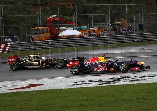 25.03.2012. Kuala Lumpur, Malaysia.  Formula 1 GP Malaysia in Kuala Lumpur Sebastian Vettel Red Bull Racing and Kimi Raikkonen Lotus F1 team