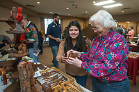 NWA Democrat-Gazette/BEN GOFF @NWABENGOFF<br /> Vera Hylton (right) of Springdale shows a carved wood piece to Leticia Cortez Saturday, Jan. 12, 2019, during the annual collectors day 'Cabin Fever Reliever' at the Shiloh Museum of Ozark History in Springdale. Vera Hylton was showing some pieces she carved herself as well as those she has collected from others. Dozens of local collectors set up tables showcasing their collections of such various things as kitchen utensils, coins, buttons, hand fans, fossils woodcarving and much more.