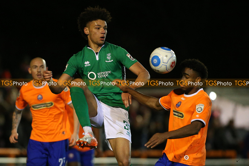 Lee Angol of Lincoln City and Reece Hall-Johnson of Braintree Town during Braintree Town vs Lincoln City, Vanarama National League Football at the IronmongeryDirect Stadium on 7th March 2017