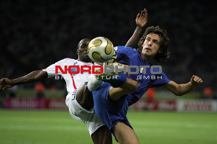 FIFA WM 2006 - Final / Finale<br /> <br /> Play #64 (09-Jul) - Italy vs France.<br /> <br /> Andrea Pirlo (r) from Italy and Claude Makelele (l) from France fight for the ball during the match of the World Cup in Berlin.<br /> <br /> Foto &copy; nordphoto