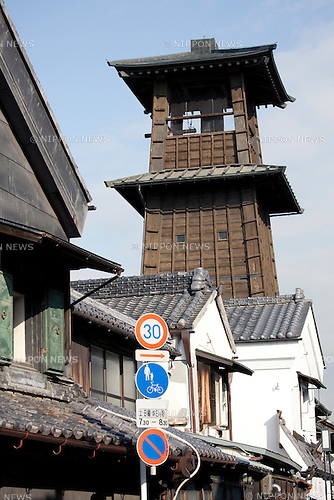 "February 14, 2013, Kawagoe, Japan - The 16 meter Toki no Kane (Time Bell Tower) is the symbol of Kawagoe from the beginning of Edo Period. An old town from Edo Period (1603-1867) is located in Kawagoe, 30 minutes by train from central Tokyo. In the past Kawagoe was an important city for trade and strategic purpose, the shogun installed some of their most important loyal men as lords of Kawagoe Castle. Every year ""Kawagoe Festival"" is held in the third weekend of October, people pull portable shrine during the parade, later ""dashi"" floats on the streets nearby. The festival started 360 years ago supported by Nobutsuna Matsudaira, lord of Kawagoe Castle. (Photo by Rodrigo Reyes Marin/AFLO).."