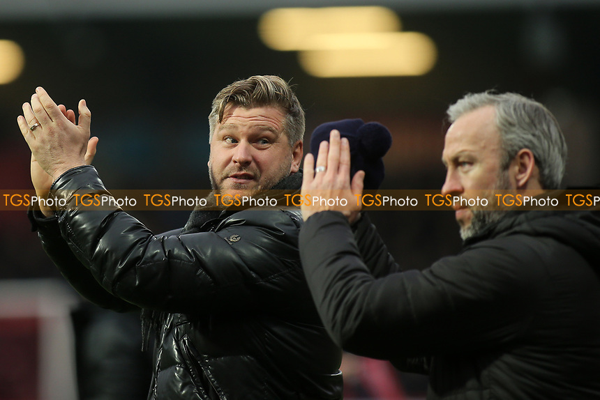 Oxford United Manager, Karl Robinson applauds the away fans alongside his first team coach, Shaun Derry during Brentford vs Oxford United, Emirates FA Cup Football at Griffin Park on 5th January 2019