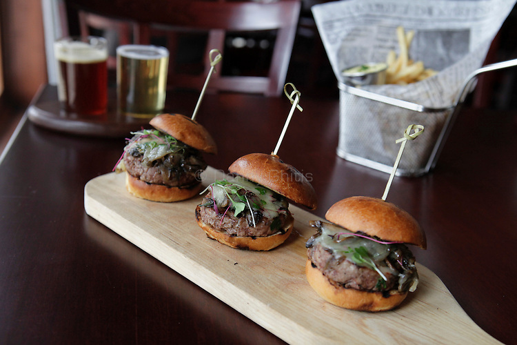 Filet mignon sliders served with french fries and a dark and light beer flight at Aperitif, a French bistro in Rockville Centre that specialzes in small dishes and wines. .(October 15, 2010).Photo by Danny Ghitis