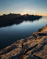 Sun setting across Øyfjord from summit of Riven, Senja, Norway
