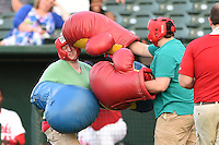 Peoria Chiefs fans participate in an on field promotion during a game against the Kane County Cougars on June 2, 2014 at Dozer Park in Peoria, Illinois.  Peoria defeated Kane County 5-3.  (Mike Janes/Four Seam Images)