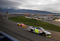 Feb 22, 2009; Fontana, CA, USA; NASCAR Sprint Cup Series driver Jimmie Johnson (48) leads teammate Jeff Gordon (24) during the Auto Club 500 at Auto Club Speedway. Mandatory Credit: Mark J. Rebilas-