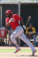 Julio Concepcion #60 of the Los Angeles Angels bats during a Minor League Spring Training Game against the Oakland Athletics at the Los Angeles Angels Spring Training Complex on March 17, 2014 in Tempe, Arizona. (Larry Goren/Four Seam Images)