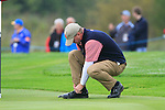 Steve Stricker ties his laces on the 8th hole during Practice Day 3 of the The 2010 Ryder Cup at the Celtic Manor, Newport, Wales, 29th September 2010..(Picture Eoin Clarke/www.golffile.ie)