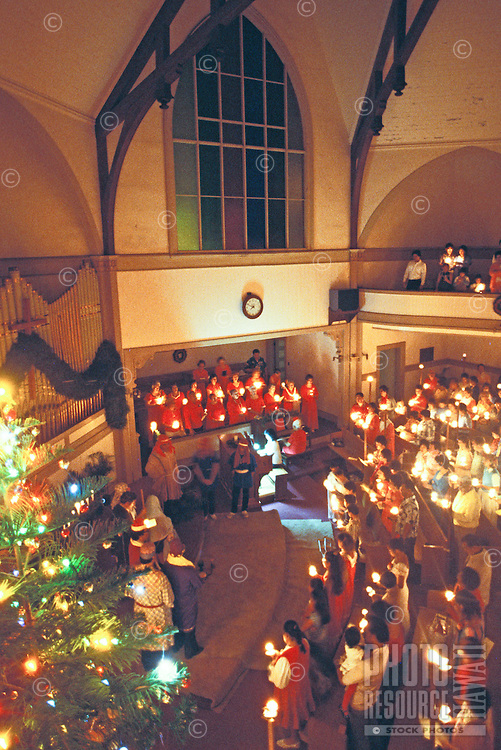 Scenes of Christmas in Hawaii, candle ceremony at Kaumakapili church