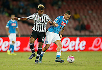 Napoli's Marek Hamsik fight for the ball with Juventus' Mario Lemina  during the  italian serie a soccer match,    at  the San  Paolo   stadium in Naples  Italy , September 26 , 2015