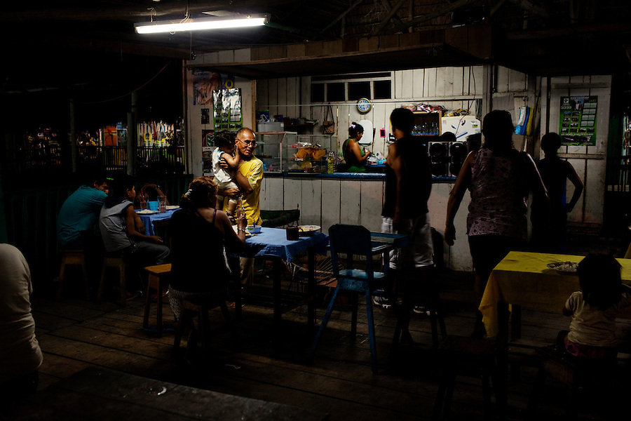 Iquitos, Peru, September 14, 2013 -  Locals having dinner at the Mercado Artesenal Anaconda just below the Malecón. This more traditional artisan market has seen a decline in business over the last few years.