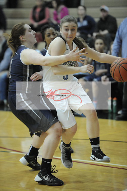 Chugiak's Nicole Pinckney drives past the Wolves' Hannah Yaw.  Photo for the Star by Michael Dinneen.