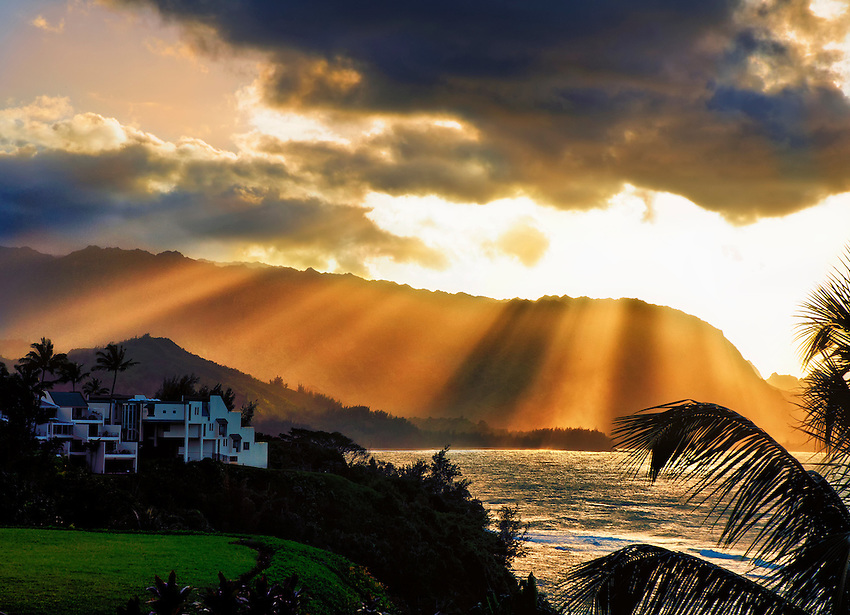 A late afternoon sun sends beams through the clouds over Bali Hai, viewed from Princeville, Kauai, Hawaii