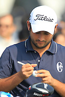 Alexander Levy (FRA) marks his ball on the 1st tee to start his match during Sunday's Final Round of the 2014 BMW Masters held at Lake Malaren, Shanghai, China. 2nd November 2014.<br /> Picture: Eoin Clarke www.golffile.ie