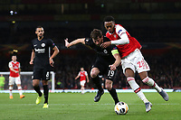 Joe Willock of Arsenal tries to shake off a challenge from David Abraham of Eintracht Frankfurt during Arsenal vs Eintracht Frankfurt, UEFA Europa League Football at the Emirates Stadium on 28th November 2019