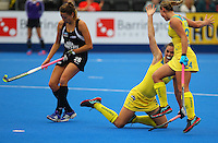 Grace Stewart of the Hockeyroos goes down during the Australia v New Zealand match at Lee Valley Hockey Centre, Olympic Park, England on 19 June 2016. Photo by Steve McCarthy / PRiME Media Images.